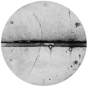 Photograph of a cloud chamber showing the first discovered positron.