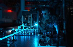 An airman conducts a laser experiment.